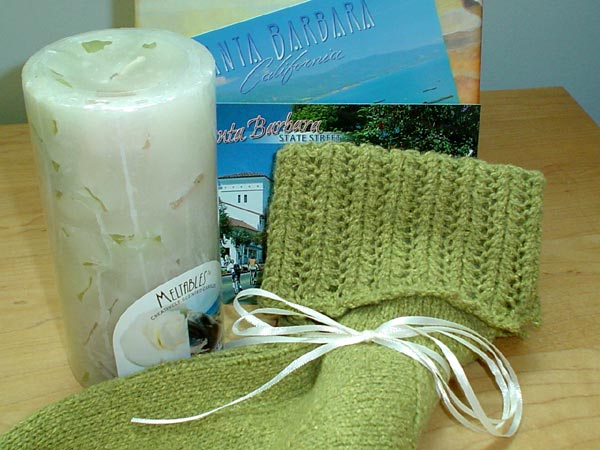 Rachel's sage green socks, candle and Santa Barbara post cards