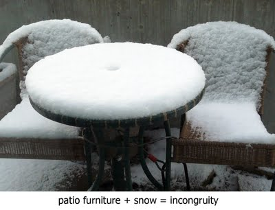 first snow on patio chairs